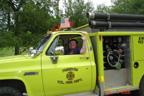Joan driving fire truck